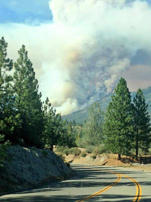 "<div class=""meta image-caption""><div class=""origin-logo origin-image kfsn""><span>KFSN</span></div><span class=""caption-text"">A fire erupted southeast of Bass Lake on Saturday, July 25, 2015. (Action News reporter Veronica Miracle)</span></div>"