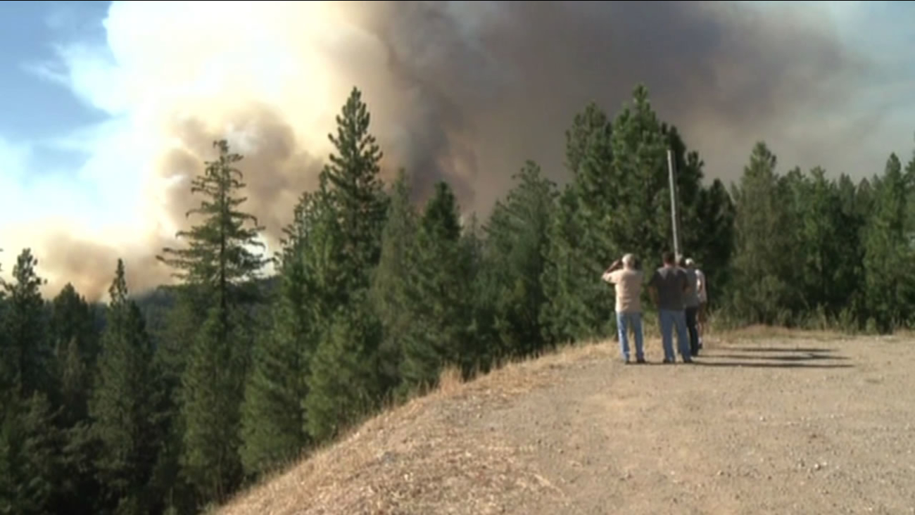 A fast-moving wildfire is spreading in Nevada and Placer Counties on Saturday, July 25, 2015.