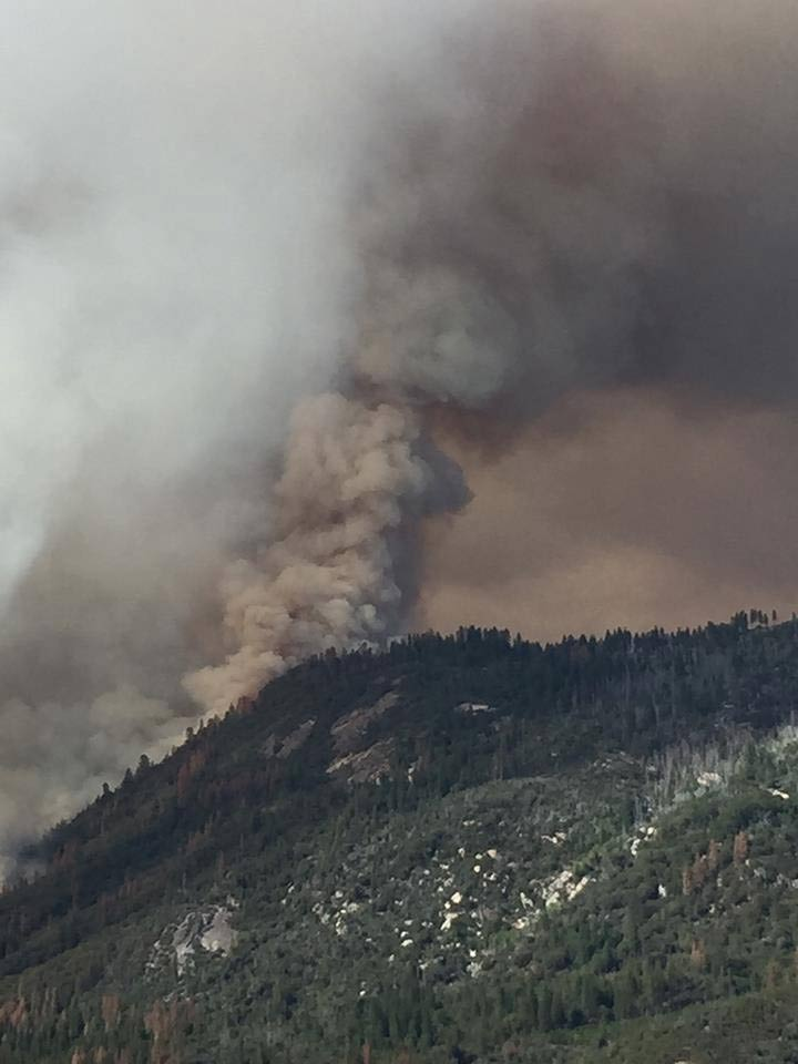 "<div class=""meta image-caption""><div class=""origin-logo origin-image kfsn""><span>KFSN</span></div><span class=""caption-text"">A fire erupted southeast of Bass Lake on Saturday, July 25, 2015. (#abc30insider Andrea Camacho)</span></div>"