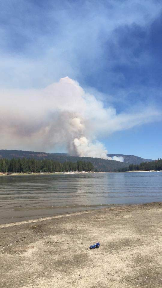 "<div class=""meta image-caption""><div class=""origin-logo origin-image kfsn""><span>KFSN</span></div><span class=""caption-text"">A fire erupted southeast of Bass Lake on Saturday, July 25, 2015. (#abc30insider Deanne Postlewait)</span></div>"