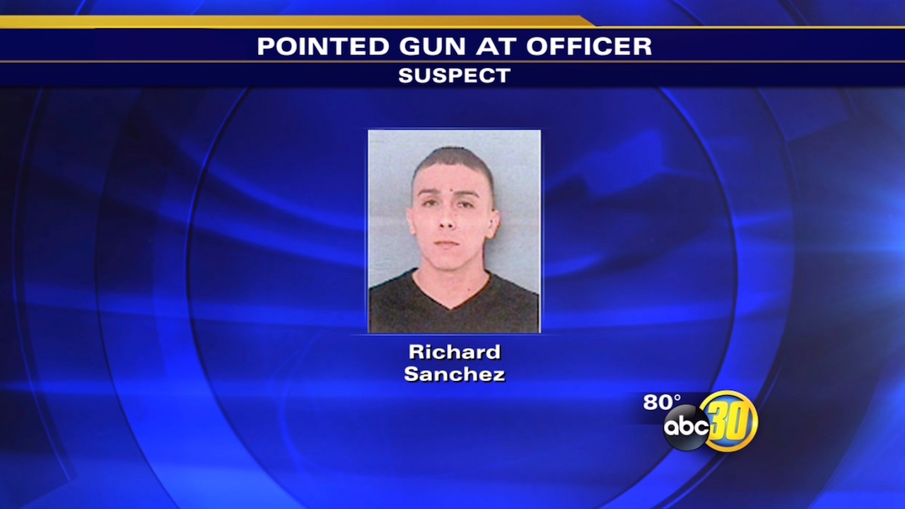 Richard Sanchez, 26, is accused of pointing a gun at a Dinuba police officer.