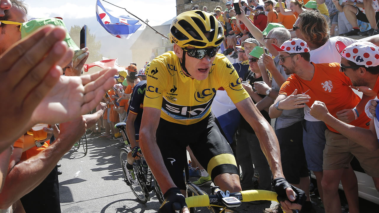 Britain's Chris Froome, wearing the overall leader's yellow jersey, climbs towards Alpe d'Huez during the twentieth stage of the Tour de France.
