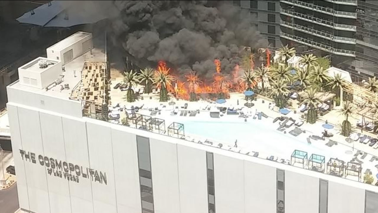 Smokes billows from a fire on the outside pool area of the Cosmopolitan Las Vegas hotel-casino Saturday, July 25, 2015, in Las Vegas.