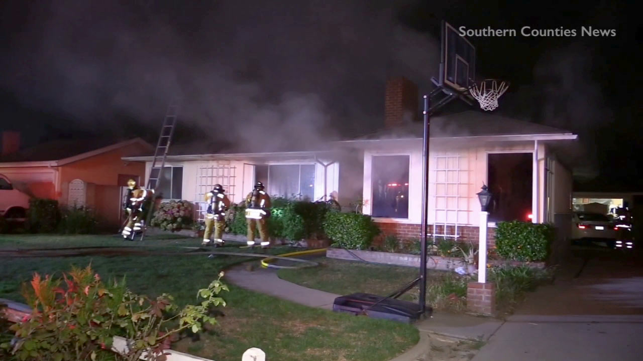 Six members of a Garden Grove family had to be hospitalized after their home caught fire on the 9000 block of Imperial Avenue on Tuesday, July 28, 2015.
