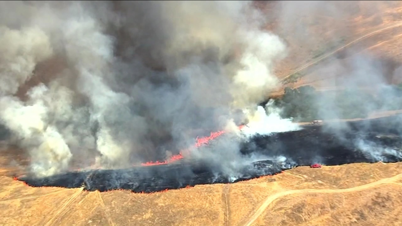 Cal Fire and U.S. military firefighters contained a 250-acre brush fire on the Camp Parks Reserve Forces Training Area in Dublin near the Santa Rita Jail on Tuesday, July 28, 2015