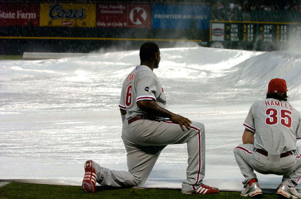 <div class='meta'><div class='origin-logo' data-origin='none'></div><span class='caption-text' data-credit='Photo/John Leyba'>Philadelphia Phillies first baseman Ryan Howard, left, joins pitcher Cole Hamels in holding down the tarp in Denver on Sunday, July 8, 2007.</span></div>