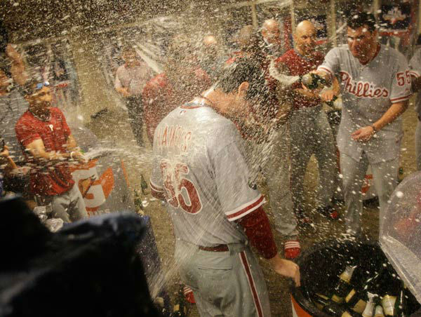 <div class='meta'><div class='origin-logo' data-origin='none'></div><span class='caption-text' data-credit='Photo/Al Behrman'>Cole Hamels gets sprayed with champagne in the clubhouse after his 2-0, complete game win over the Reds in Game 3 of NLDS, Oct. 10, 2010.</span></div>