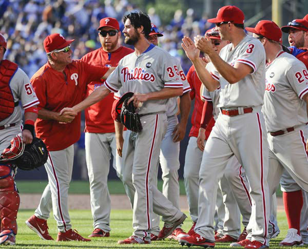 <div class='meta'><div class='origin-logo' data-origin='none'></div><span class='caption-text' data-credit='Photo/Matt Marton'>Cole Hamels, center, is congratulated by teammates after he pitched a no-hitter against the Chicago Cubs on Saturday, July 25, 2015.</span></div>