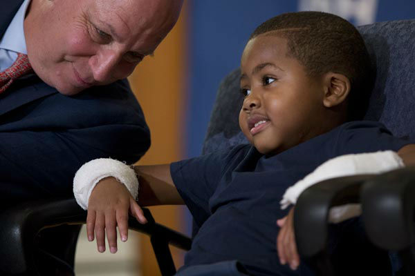 "<div class=""meta image-caption""><div class=""origin-logo origin-image none""><span>none</span></div><span class=""caption-text"">As Dr. L. Scott Levin holds speaks with double-hand transplant recipient eight-year-old Zion Harvey during a news conference Tuesday, July 28, 2015 (AP Photo/ Matt Rourke)</span></div>"