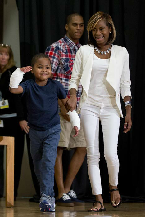 "<div class=""meta image-caption""><div class=""origin-logo origin-image none""><span>none</span></div><span class=""caption-text"">Double-hand transplant recipient eight-year-old Zion Harvey arrives to a news conference with his mother Pattie Ray Tuesday, July 28, 2015 (AP Photo/ Matt Rourke)</span></div>"