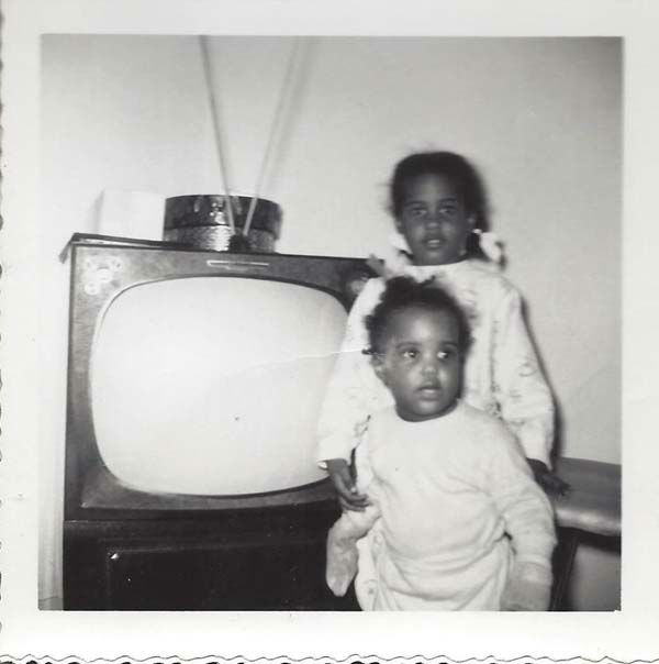 <div class='meta'><div class='origin-logo' data-origin='none'></div><span class='caption-text' data-credit='KTRK Photo'>Melanie Lawson with her little sister - notice the big tube TV!</span></div>
