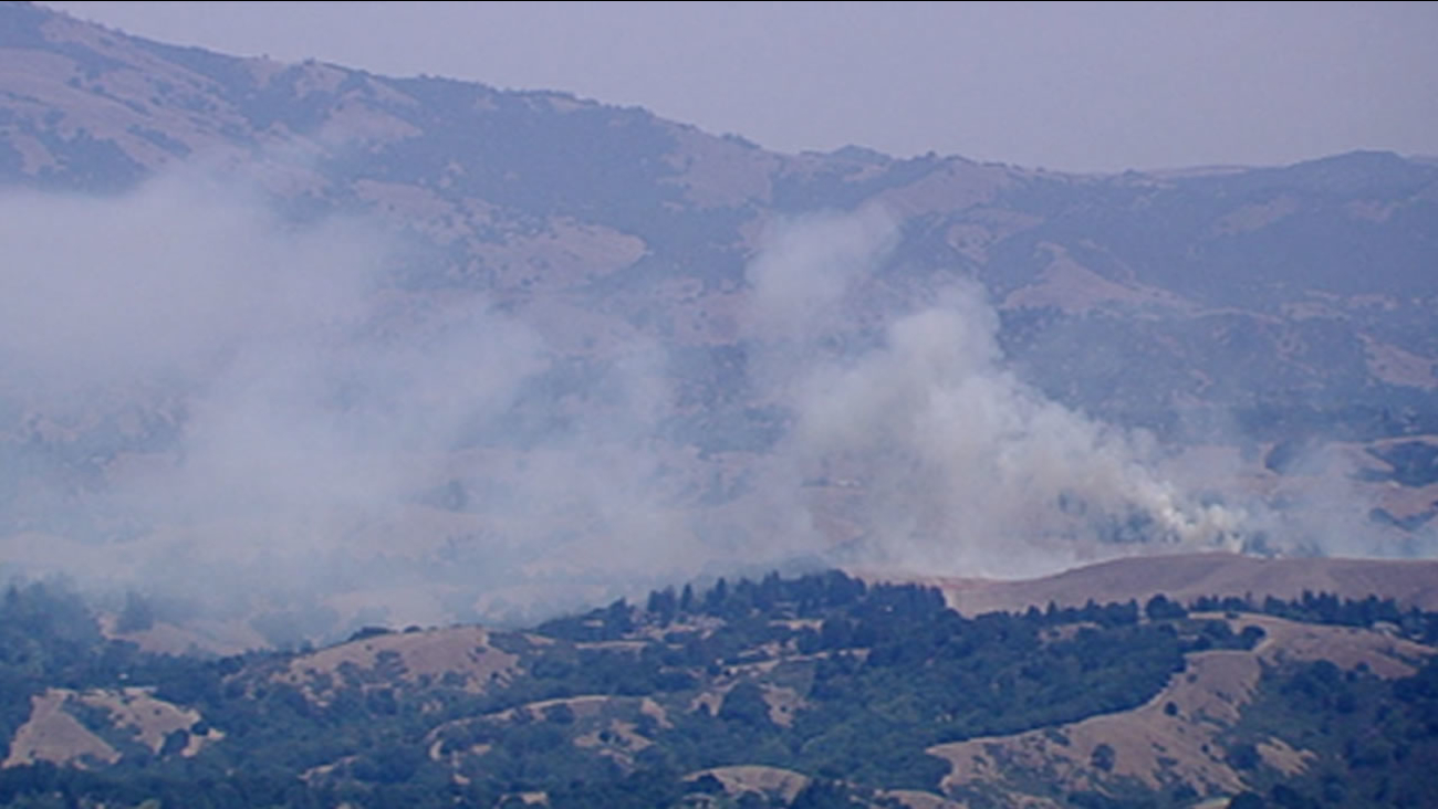 Smoke rises from a brush fire outside of Livermore, Calif.  on Vasco Road, July 30, 2015.