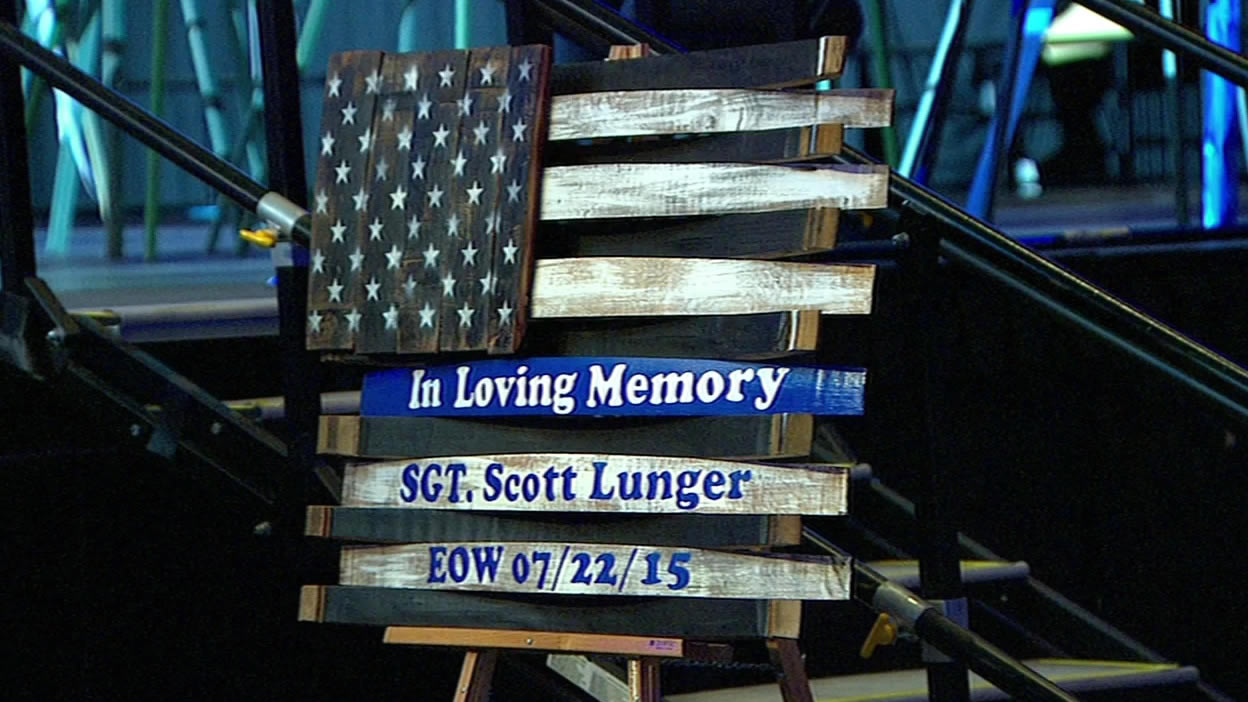 "<div class=""meta image-caption""><div class=""origin-logo origin-image none""><span>none</span></div><span class=""caption-text"">Remembering Sergeant Scott Lunger at his memorial at Oracle Arena in Oakland, Calif. on Thursday, July 30, 2015. (AP)</span></div>"