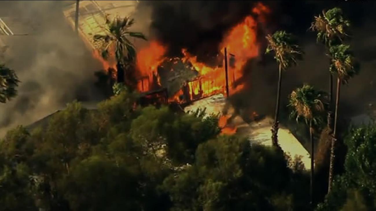 Crews battled a brush fire that burned several mobile homes in Isleton along the Sacramento River on Thursday, July 30, 20.15.