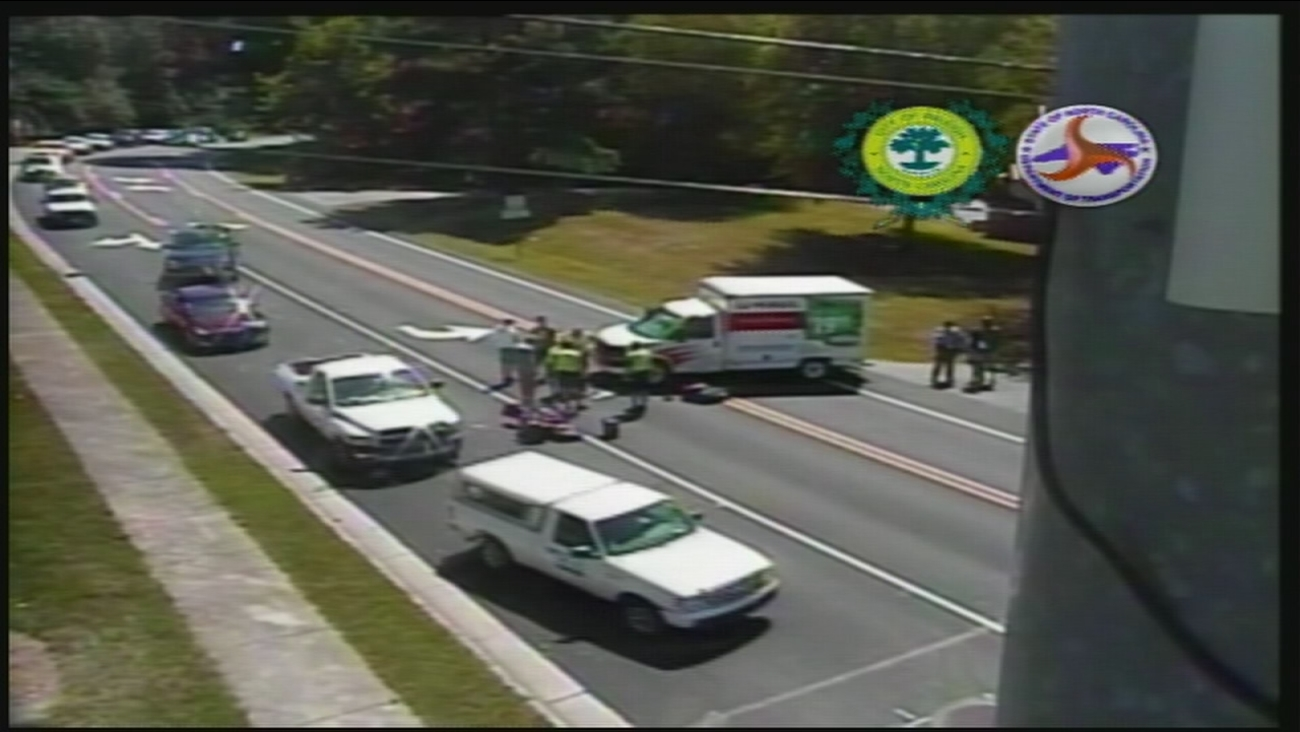 Emergency workers on the scene after a motorcyclist and a U-Haul truck collided
