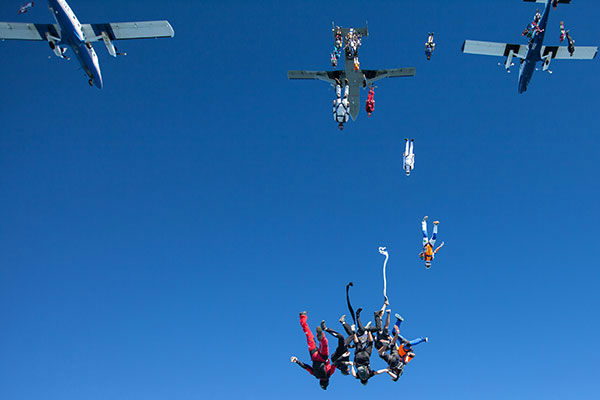"""<div class=""""meta image-caption""""><div class=""""origin-logo origin-image none""""><span>none</span></div><span class=""""caption-text"""">Members of an international team of skydivers exit jump planes flying head-down on their way to building their world record skydiving formation. (Photo/Jason Peters)</span></div>"""