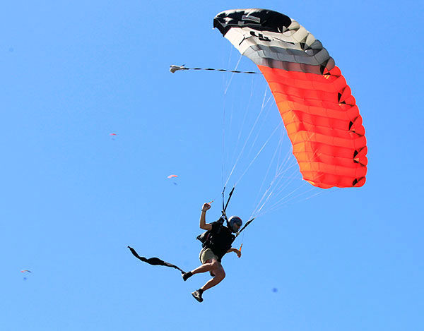 """<div class=""""meta image-caption""""><div class=""""origin-logo origin-image none""""><span>none</span></div><span class=""""caption-text"""">A skydiver is seen after exiting a plane during a world record jump at Skydive Chicago. It took the international team 13 attempts to beat the 2012 mark set by 138 skydivers (Photo/Christian K. Lee)</span></div>"""