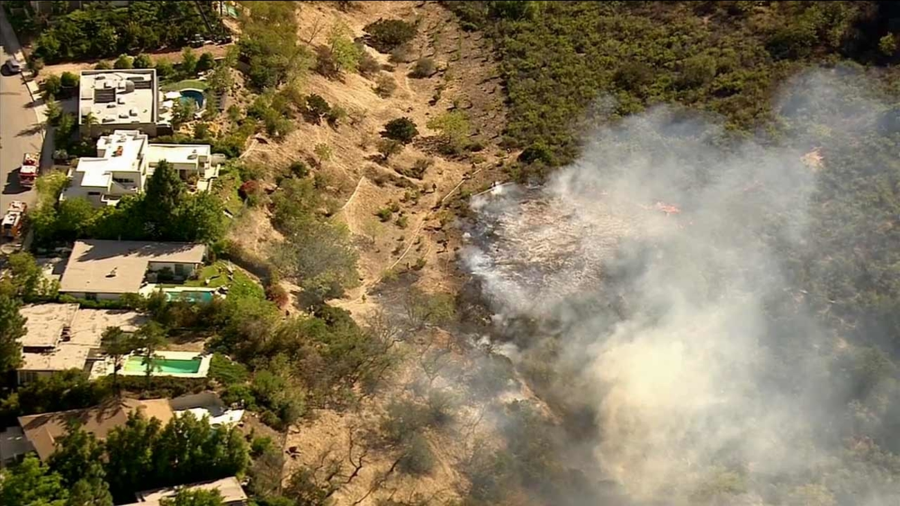 A slow-moving blaze erupted in brush in the 14600 block of W. Deervale Place in Sherman Oaks Friday, July 31, 2015.