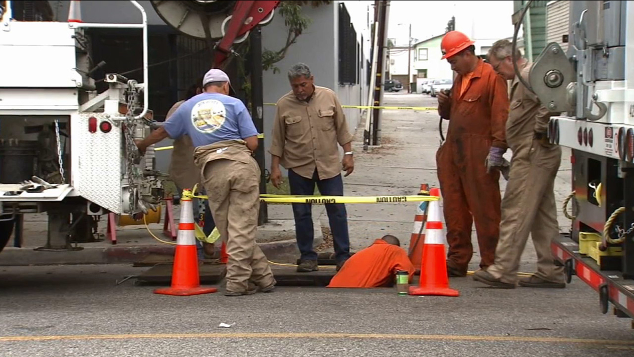 Southern California Edison crews inspect underground vaults and work to restore power to customers in Long Beach on Friday, July 31, 2015.