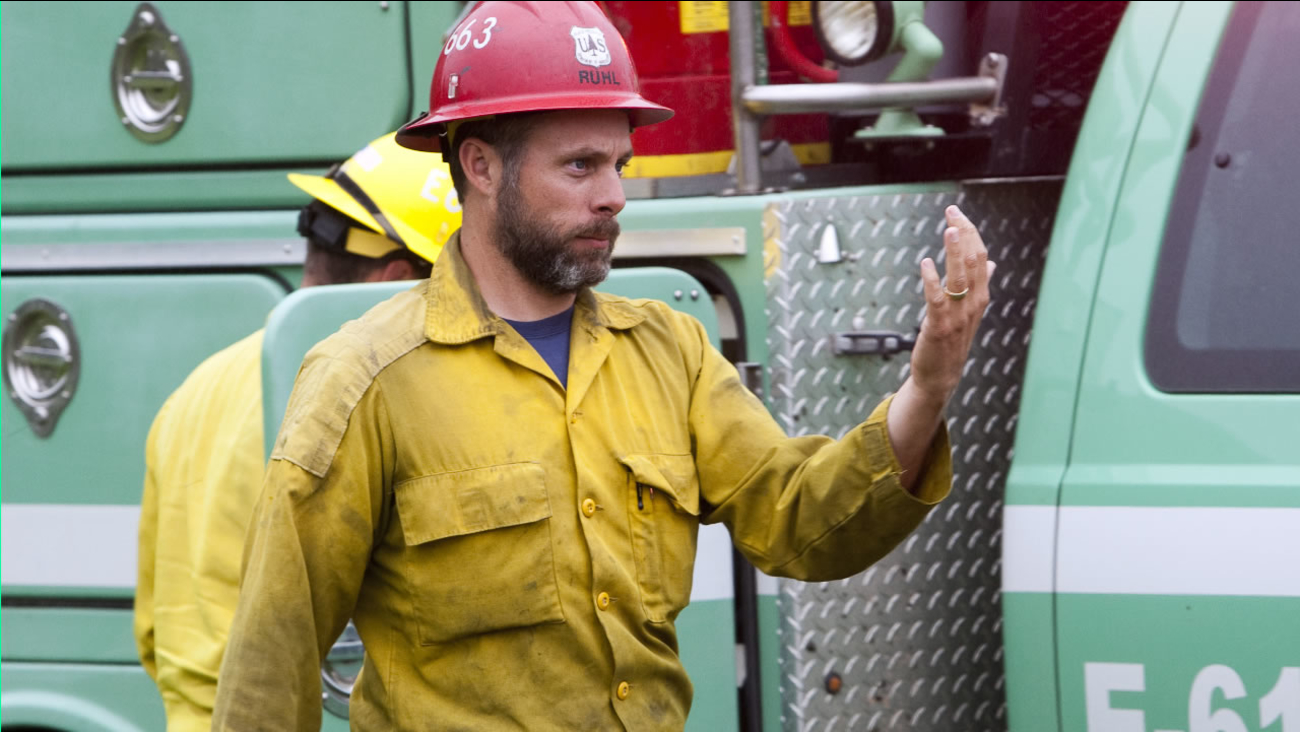 This 2014 photo provided by the Black Hills, S.D., National Forest shows U.S. Forest Service firefighter David Ruhl in the national forest near Custer, S.D.  (AP Photo)