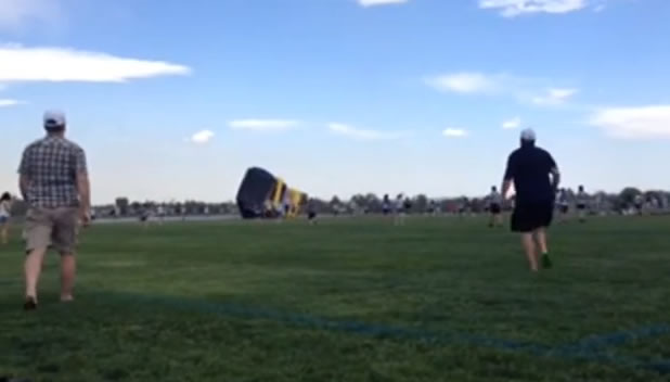 Two children were injured when an inflatable bouncy slide broke loose in Colorado.