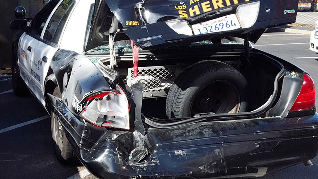 The mangled trunk of a Los Angeles County Sheriff's Department patrol car is shown after an SUV crashed into it in West Hollywood on Friday, July 31, 2015.