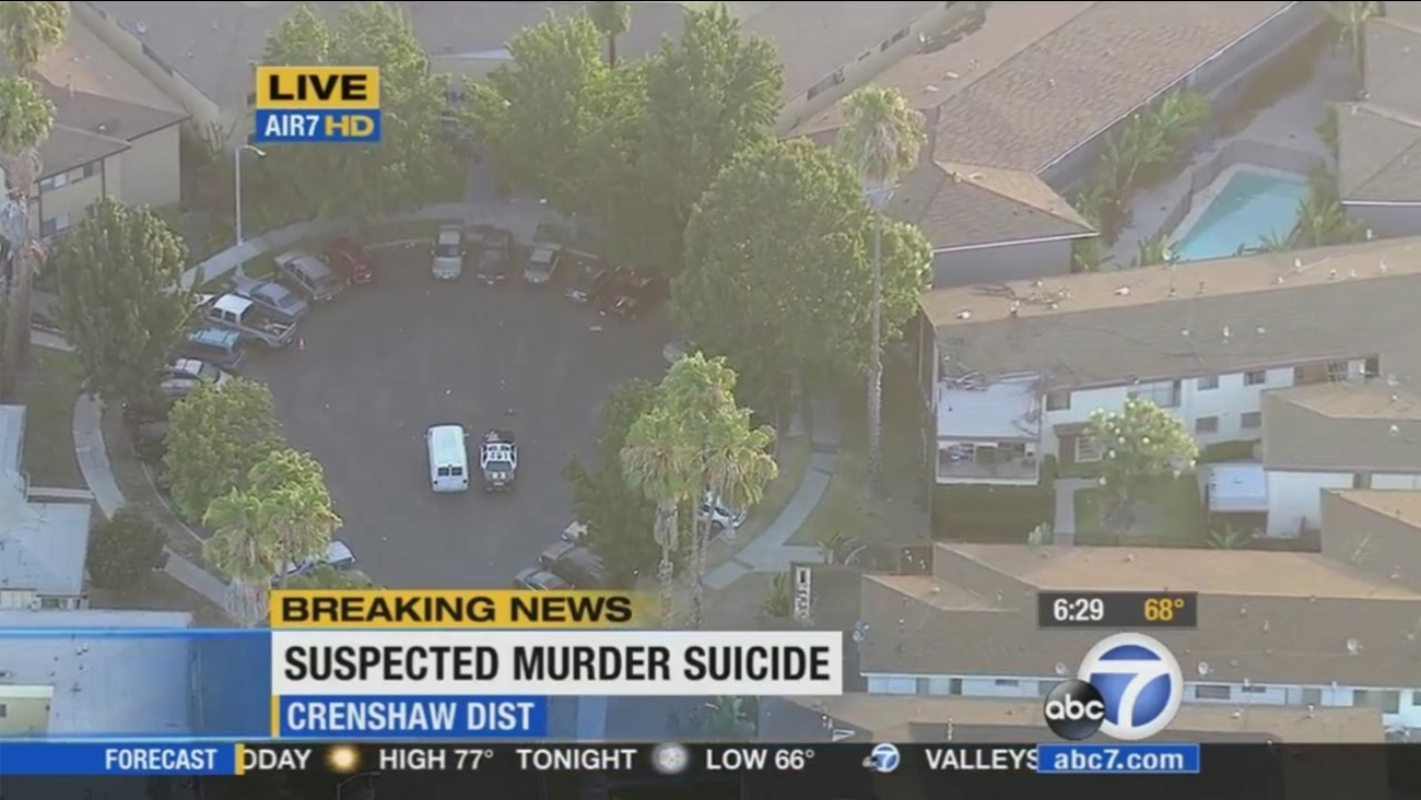 A patrol vehicle and a coroner's van are shown near the scene of a possible murder-suicide in the Crenshaw District on Monday, Aug. 3, 2015.