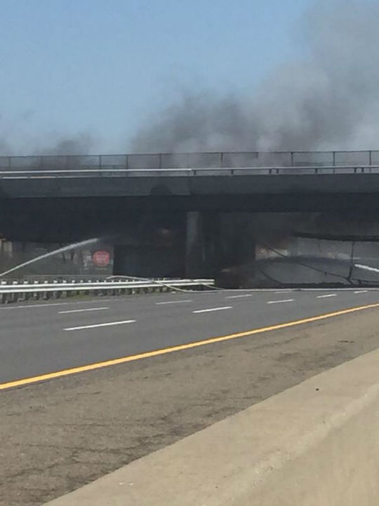 """<div class=""""meta image-caption""""><div class=""""origin-logo origin-image none""""><span>none</span></div><span class=""""caption-text"""">Traffic on the New Jersey Turnpike was backed up for miles in both directions after a dump truck overturned and caught fire. (@drbreewill)</span></div>"""