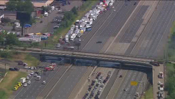 """<div class=""""meta image-caption""""><div class=""""origin-logo origin-image none""""><span>none</span></div><span class=""""caption-text"""">Traffic on the New Jersey Turnpike was backed up for miles in both directions after a dump truck overturned and caught fire.</span></div>"""