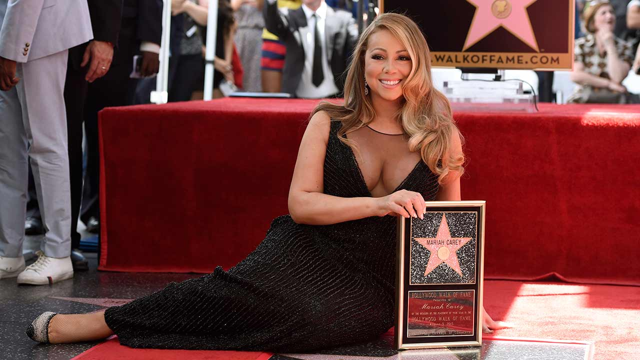 Mariah Carey poses during ceremony honoring her with a star on the Hollywood Walk of Fame on Wednesday, Aug. 5, 2015 in Los Angeles.