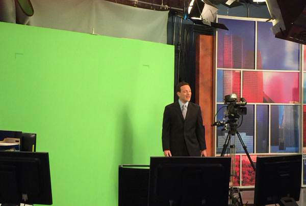 """<div class=""""meta image-caption""""><div class=""""origin-logo origin-image none""""><span>none</span></div><span class=""""caption-text"""">Travis doing the weather in front of the green screen (KTRK Photo)</span></div>"""
