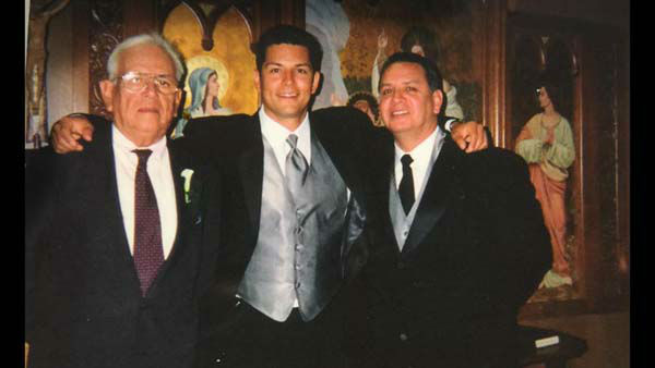 <div class='meta'><div class='origin-logo' data-origin='none'></div><span class='caption-text' data-credit='KTRK Photo'>Erik Barajas with his family on his wedding day, 14 years ago</span></div>