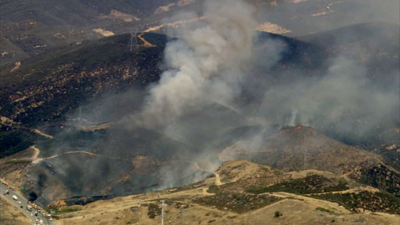 A brush fire erupted along the northbound 5 Freeway near Templin Highway in the Castaic area on Thursday, Aug. 6, 2015.