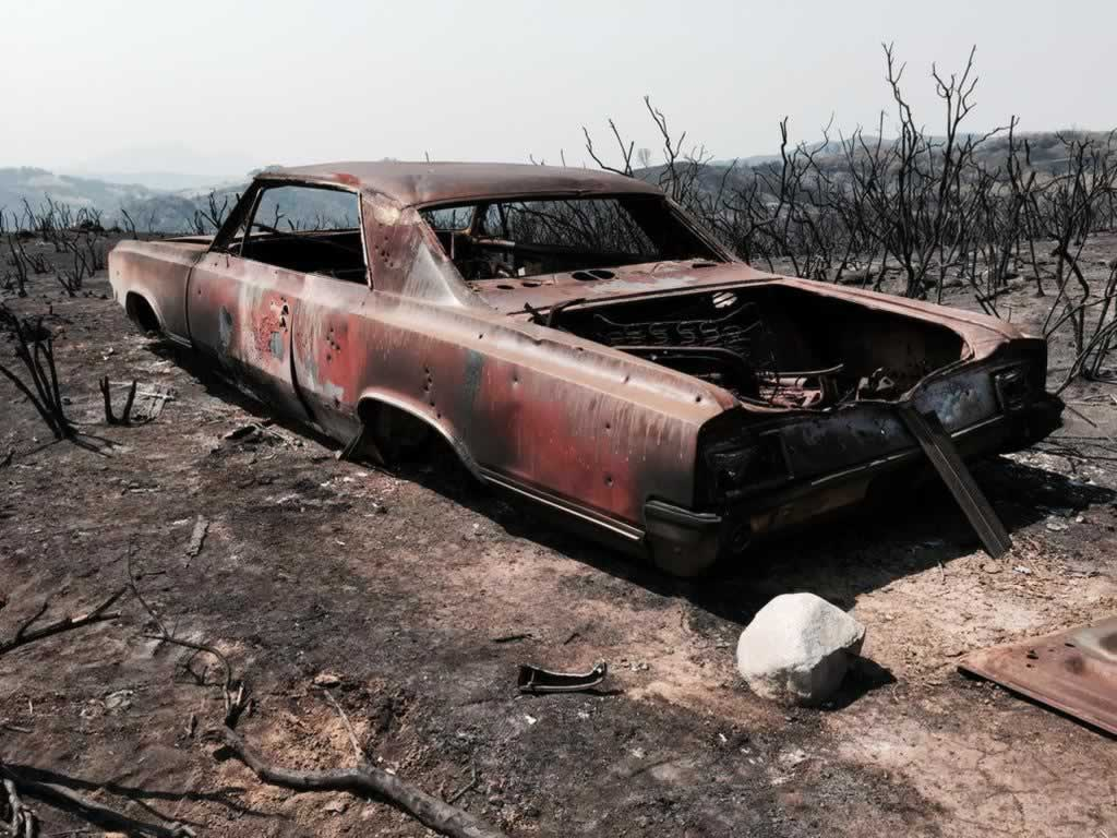 "<div class=""meta image-caption""><div class=""origin-logo origin-image none""><span>none</span></div><span class=""caption-text"">A charred car rests among the destruction from the Rocky Fire burning in Lake County, Calif. on Wednesday, August 5, 2015. (KGO-TV)</span></div>"