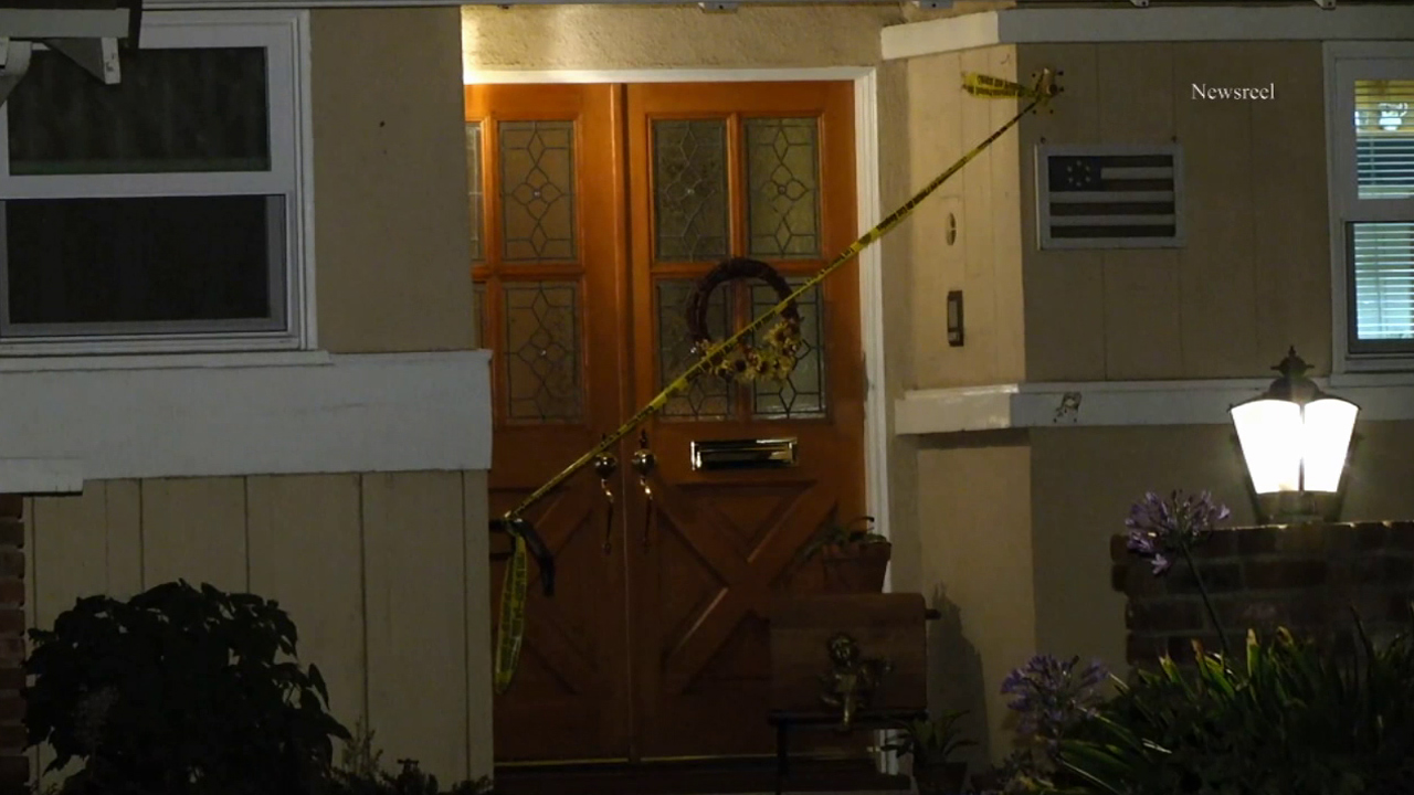 The door of a Granada Hills home is cordoned off as officers investigate the scene of a suspected sexual assault on Wednesday, Aug. 5, 2015.