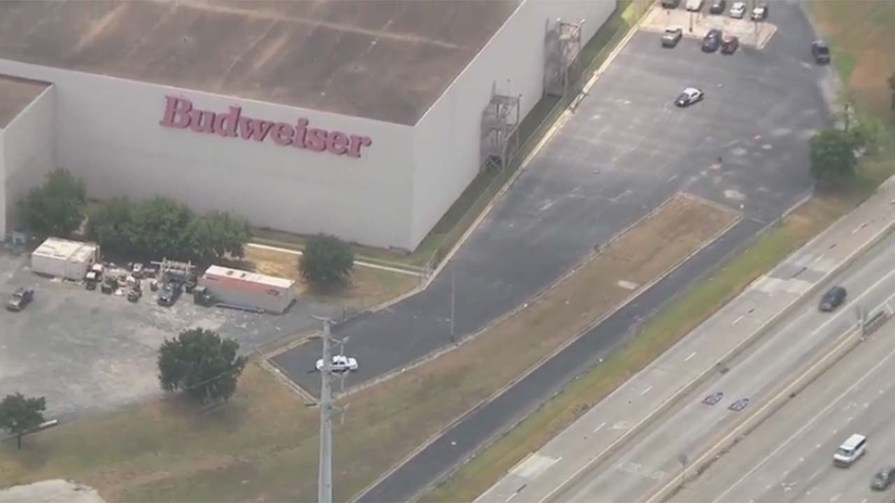 """<div class=""""meta image-caption""""><div class=""""origin-logo origin-image none""""><span>none</span></div><span class=""""caption-text"""">A search for two men at the Budweiser plant in northeast Houston. (Photo/KTRK)</span></div>"""