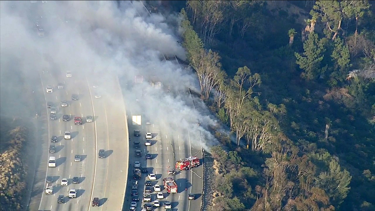 Several lanes of the eastbound 134 Freeway in Eagle Rock were shut down after a brush fire broke out Friday, Aug. 7, 2015.