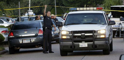 "<div class=""meta image-caption""><div class=""origin-logo origin-image none""><span>none</span></div><span class=""caption-text"">A member of the Harris County Sheriff's Department raises the crime scene tape at the scene of the deaths (AP Photo/ David J. Phillip)</span></div>"