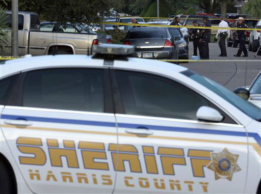 "<div class=""meta image-caption""><div class=""origin-logo origin-image none""><span>none</span></div><span class=""caption-text"">Members of the Harris County Sheriff's department work outside the scene of the shooting. (AP Photo/ David J. Phillip)</span></div>"