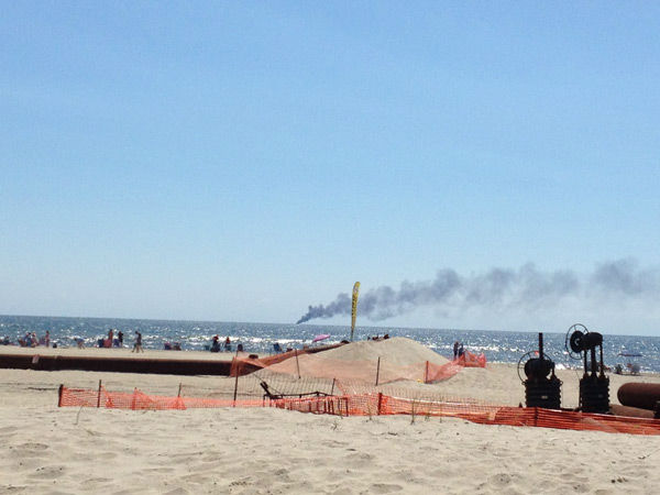 "<div class=""meta image-caption""><div class=""origin-logo origin-image none""><span>none</span></div><span class=""caption-text"">Action News viewers captured the smoke from a boat fire three miles off the coast of Ocean City, NJ on Sunday, August 9, 2015. (WPVI Photo/ Jill via 6abc Action)</span></div>"