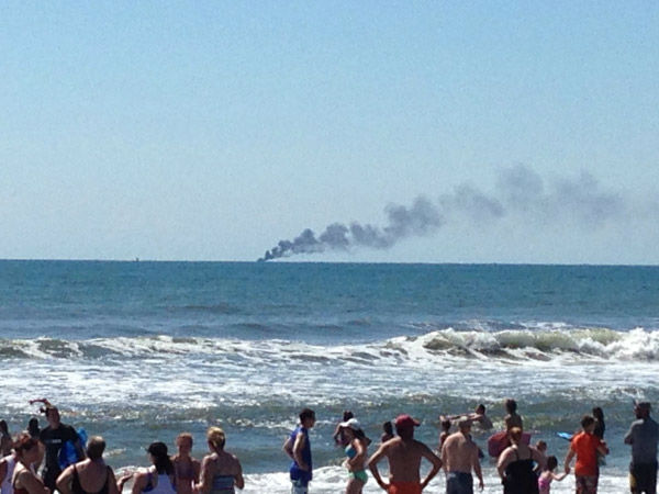 "<div class=""meta image-caption""><div class=""origin-logo origin-image none""><span>none</span></div><span class=""caption-text"">Action News viewers captured the smoke from a boat fire three miles off the coast of Ocean City, NJ on Sunday, August 9, 2015. (WPVI Photo)</span></div>"