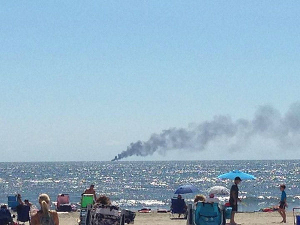 "<div class=""meta image-caption""><div class=""origin-logo origin-image none""><span>none</span></div><span class=""caption-text"">Action News viewers captured the smoke from a boat fire three miles off the coast of Ocean City, NJ on Sunday, August 9, 2015. (WPVI Photo / Linda Spadaro Mowinski via Facebook)</span></div>"