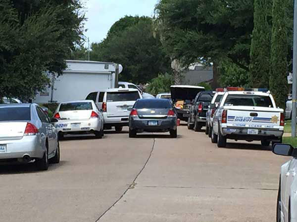 "<div class=""meta image-caption""><div class=""origin-logo origin-image none""><span>none</span></div><span class=""caption-text"">Scenes from outside a home in northwest Harris County, where eight people were found dead (Photo/Steve Campion)</span></div>"