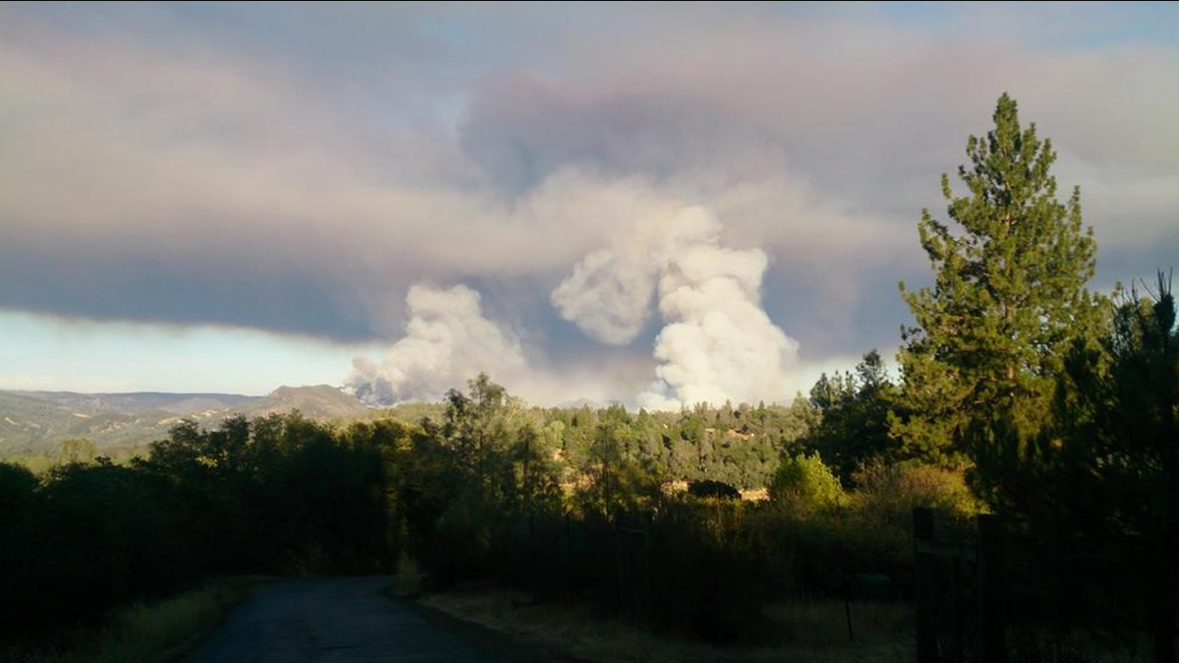 Smoke is seen from the Jerusalem Fire that prompted evacuations in Lake County, Calif. on Sunday, August 9, 2015.