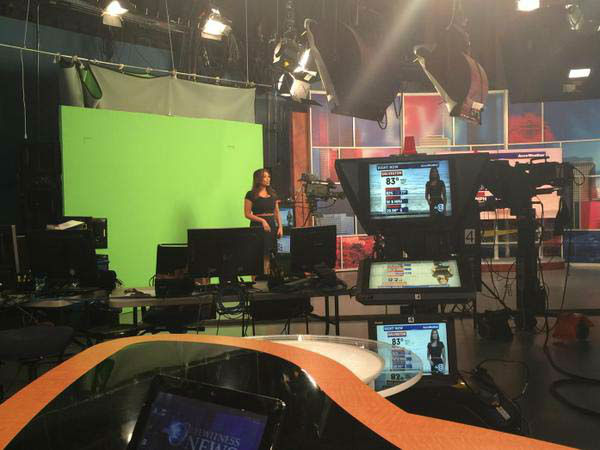 """<div class=""""meta image-caption""""><div class=""""origin-logo origin-image none""""><span>none</span></div><span class=""""caption-text"""">Elita doing the weather in front of the green screen (KTRK Photo)</span></div>"""