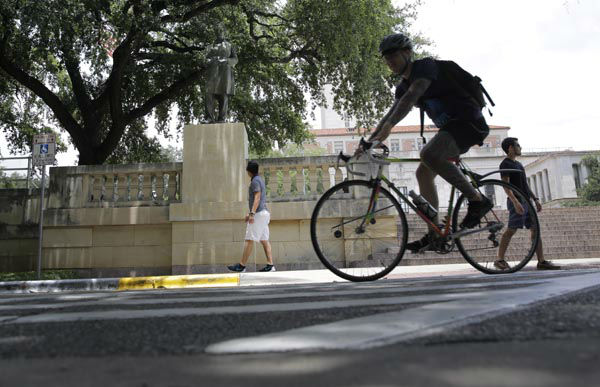 "<div class=""meta image-caption""><div class=""origin-logo origin-image none""><span>none</span></div><span class=""caption-text"">A man cycles near a statue of Jefferson Davis on the University of Texas campus, Tuesday, July 7, 2015, in Austin, Texas. (AP Photo/ Eric Gay)</span></div>"