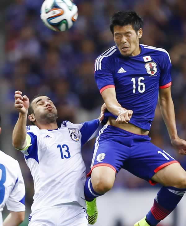 "<div class=""meta image-caption""><div class=""origin-logo origin-image ""><span></span></div><span class=""caption-text"">Japan's Hotaru Yamaguchi, right, fights for the ball with Cyprus' Konstantinos Makridis during a friendly soccer match in Saitama, north of Tokyo, Tuesday, May 27, 2014. (AP Photo/Shizuo Kambayashi)</span></div>"