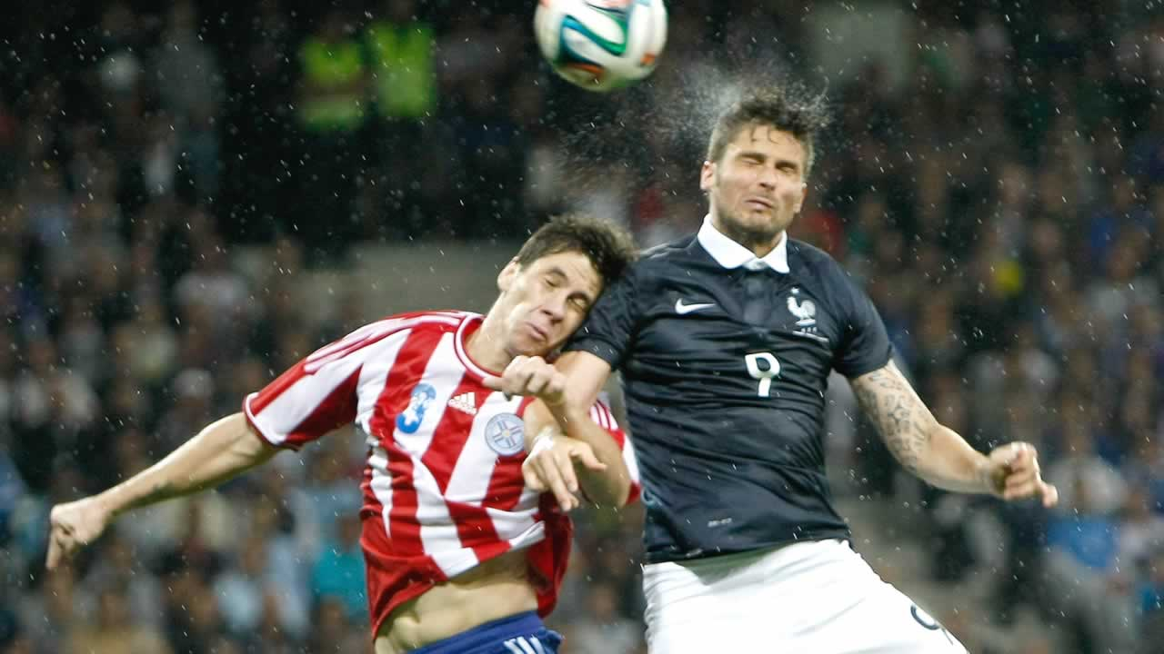 "<div class=""meta image-caption""><div class=""origin-logo origin-image ""><span></span></div><span class=""caption-text"">French soccer team forward Olivier Giroud, right, Paraguayan soccer team defender Danilo Fabian Ortiz Soto,  during the friendly soccer match between France and Paraguay on June 1. (AP Photo/Claude Paris)</span></div>"