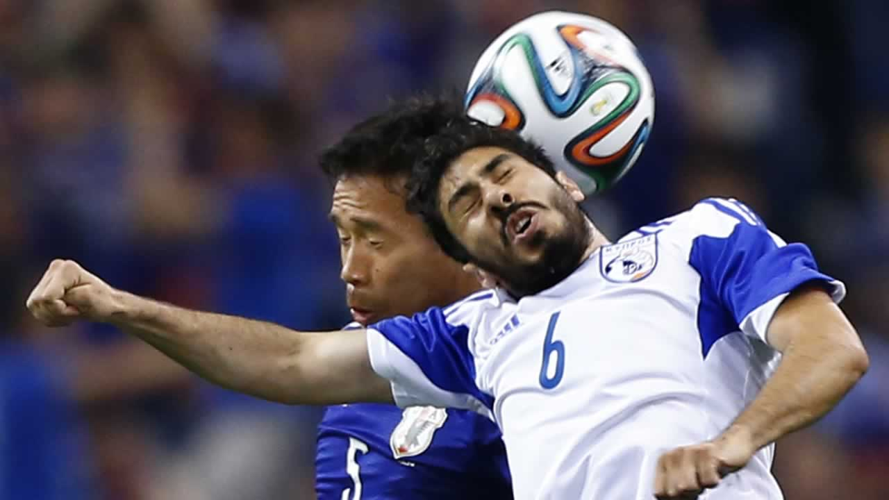 "<div class=""meta image-caption""><div class=""origin-logo origin-image ""><span></span></div><span class=""caption-text"">Cyprus' Charalambos Kyriacou, right, fights for the ball with Japan¹s Yuto Nagatomo during a friendly soccer match in Saitama, north of Tokyo, Tuesday, May 27, 2014. (AP Photo/Shizuo Kambayashi)</span></div>"