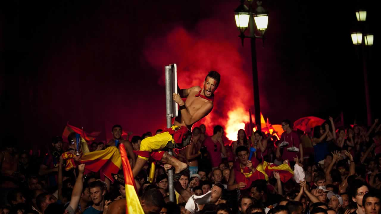 "<div class=""meta image-caption""><div class=""origin-logo origin-image ""><span></span></div><span class=""caption-text"">Spanish fans celebrate the goal as they watch in Barcelona's Plaza Espana a live broadcast of the World Cup soccer final between Spain and the Netherlands. (AP Photo/Emilio Morenatti)</span></div>"